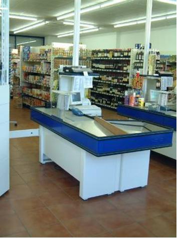 Fabricacion mobiliario comercial montaje integral for Mueble caja registradora